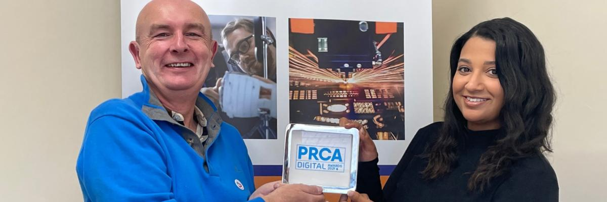 """Billy McKenna (Managing Director) and Paige Lee (Account Manager) with their recent award win: 'Best Use of Paid Media in a Campaign"""" from the PRCA Digital Awards"""