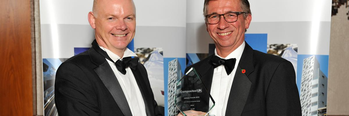 Chris Taylor of Axon Automotive collecting the award