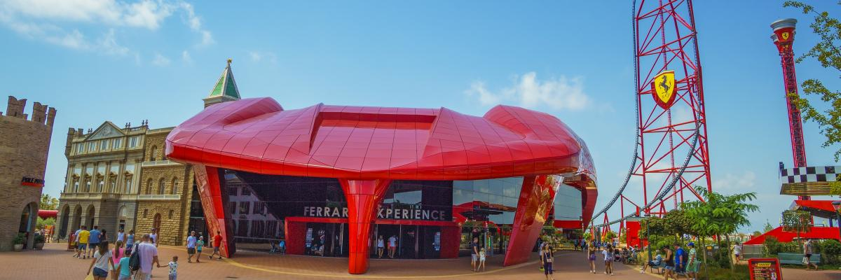 Front view of the 'Ferrari Experience' building, with car bonnet shaped entrance
