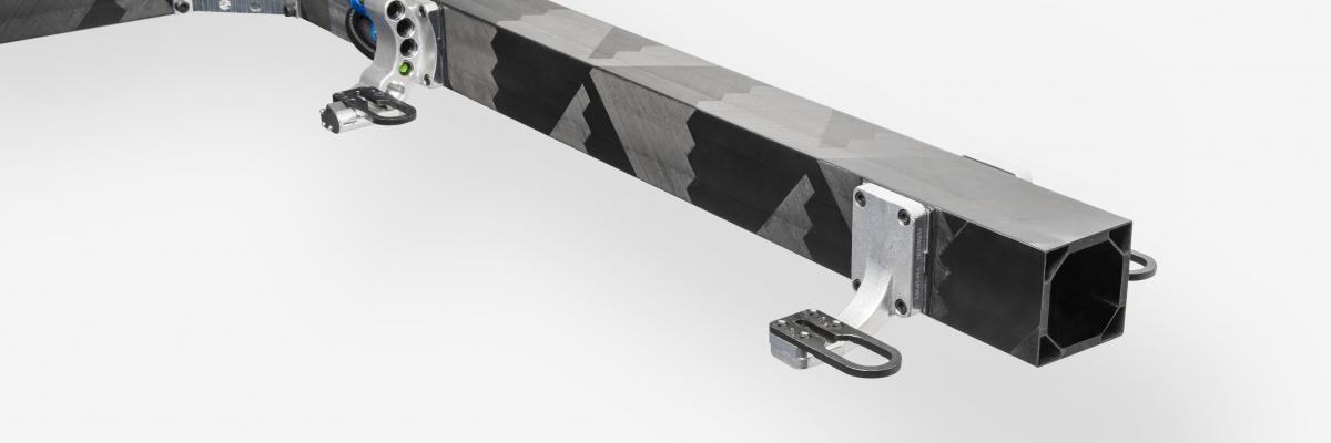 Connected beam T-boom